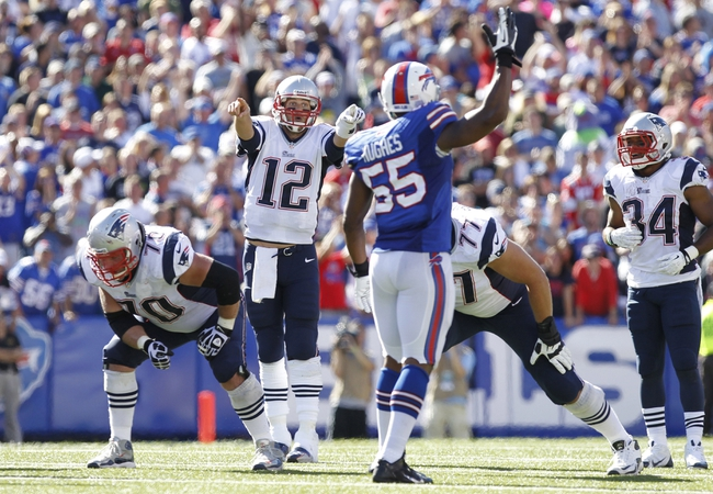Sep 8, 2013; Orchard Park, NY, USA; New England Patriots quarterback Tom Brady (12) signals a play against the Buffalo Bills during the fourth quarter at Ralph Wilson Stadium. Patriots beat the Bills 23-21. Mandatory Credit: Kevin Hoffman-USA TODAY Sports