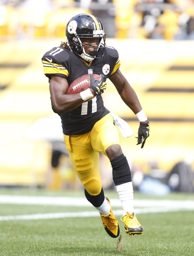 Sep 8, 2013; Pittsburgh, PA, USA; Pittsburgh Steelers wide receiver Markus Wheaton (11) returns a kick-off against the Tennessee Titans during the fourth quarter at Heinz Field. The Tennessee Titans won 16-9. Mandatory Credit: Charles LeClaire-USA TODAY Sports