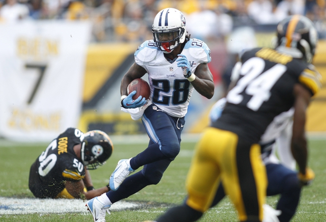 Sep 8, 2013; Pittsburgh, PA, USA; Tennessee Titans running back Chris Johnson (28) carries the ball against the Pittsburgh Steelers during the fourth quarter at Heinz Field. The Tennessee Titans won 16-9. Mandatory Credit: Charles LeClaire-USA TODAY Sports
