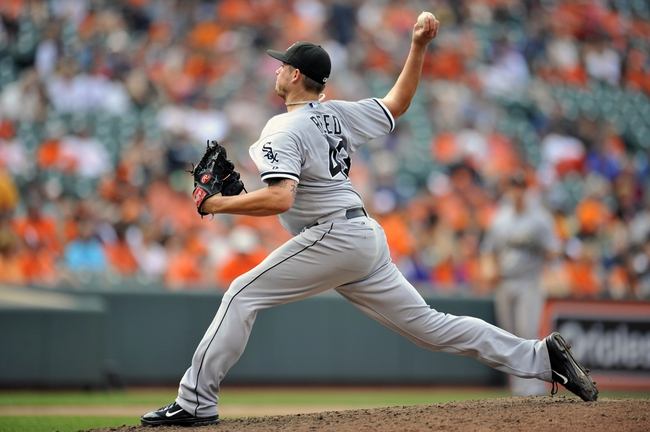 Sep 8, 2013; Baltimore, MD, USA; Chicago White Sox pitcher Addison Reed (43) throws in the ninth inning against the Baltimore Orioles at Oriole Park at Camden Yards. The White Sox defeated the Orioles 4-2. Mandatory Credit: Joy R. Absalon-USA TODAY Sports