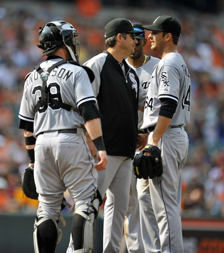 Sep 8, 2013; Baltimore, MD, USA; Chicago White Sox manager Robin Ventura (23) takes the ball from starting pitcher Andre Rienzo (64) in the seventh inning against the Baltimore Orioles at Oriole Park at Camden Yards. The White Sox defeated the Orioles 4-2. Mandatory Credit: Joy R. Absalon-USA TODAY Sports