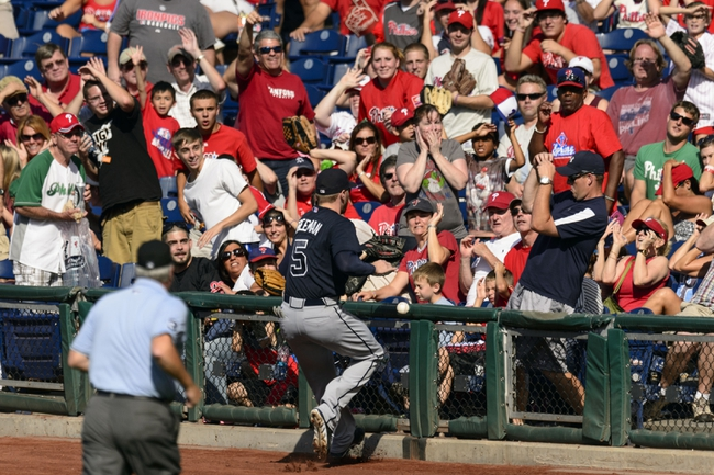 Sep 8, 2013; Philadelphia, PA, USA; Atlanta Braves first baseman Freddie Freeman (5) fails to catch a foul ball during the eighth inning against the Philadelphia Phillies at Citizens Bank Park. The Phillies defeated the Braves 3-2. Mandatory Credit: Howard Smith-USA TODAY Sports