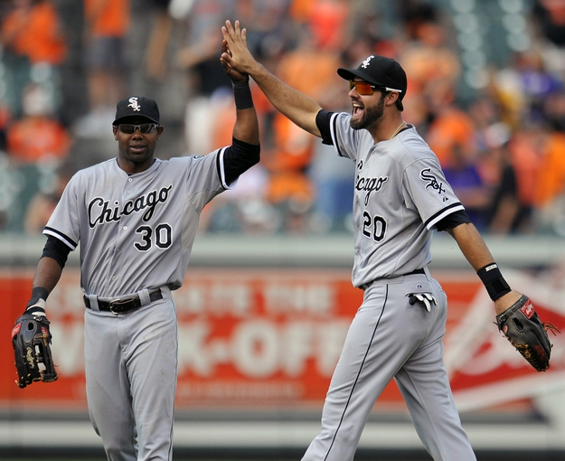 Sep 8, 2013; Baltimore, MD, USA; Chicago White Sox teammates Alejandro De Aza (30) and White Sox Jordan Danks (20) celebrate after the game against the Baltimore Orioles at Oriole Park at Camden Yards. The White Sox defeated the Orioles 4-2. Mandatory Credit: Joy R. Absalon-USA TODAY Sports