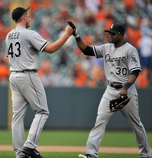 Sep 8, 2013; Baltimore, MD, USA; Chicago White Sox teammates Addison Reed (43) and White Sox Alejandro De Aza (30) celebrate after the game against the Baltimore Orioles at Oriole Park at Camden Yards. The White Sox defeated the Orioles 4-2. Mandatory Credit: Joy R. Absalon-USA TODAY Sports