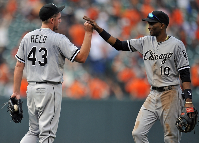 Sep 8, 2013; Baltimore, MD, USA; Chicago White Sox teammates Addison Reed (43) and White Sox Alexei Ramirez (10) celebrate after the game against the Baltimore Orioles at Oriole Park at Camden Yards. The White Sox defeated the Orioles 4-2. Mandatory Credit: Joy R. Absalon-USA TODAY Sports