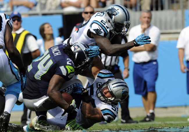 Sep 8, 2013; Charlotte, NC, USA; Carolina Panthers linebacker Luke Kuechly (59) stops Seattle Seahawks running back Marshawn Lynch (24) just short of the goal line during the game at Bank of America Stadium.  Seattle wins 12-7.  Mandatory Credit: Sam Sharpe-USA TODAY Sports