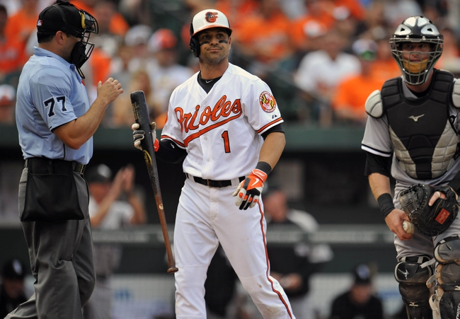 Sep 8, 2013; Baltimore, MD, USA; Baltimore Orioles designated hitter Brian Roberts (1) reacts after striking out in the seventh inning against the Chicago White Sox at Oriole Park at Camden Yards. The White Sox defeated the Orioles 4-2. Mandatory Credit: Joy R. Absalon-USA TODAY Sports