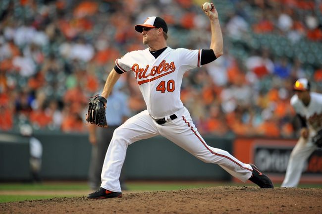 Sep 8, 2013; Baltimore, MD, USA; Baltimore Orioles pitcher Troy Patton (40) throws in the ninth inning against the Chicago White Sox at Oriole Park at Camden Yards. The White Sox defeated the Orioles 4-2. Mandatory Credit: Joy R. Absalon-USA TODAY Sports