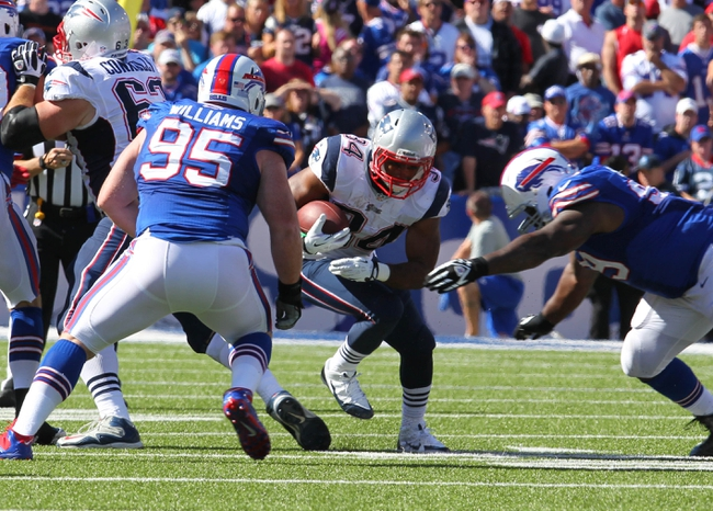 Sep 8, 2013; Orchard Park, NY, USA; Buffalo Bills defensive tackle Kyle Williams (95) and defensive tackle Marcell Dareus (99) look to make a tackle on New England Patriots running back Shane Vereen (34) during the second half at Ralph Wilson Stadium.  Patriots beat the Bills 23 to 21.  Mandatory Credit: Timothy T. Ludwig-USA TODAY Sports