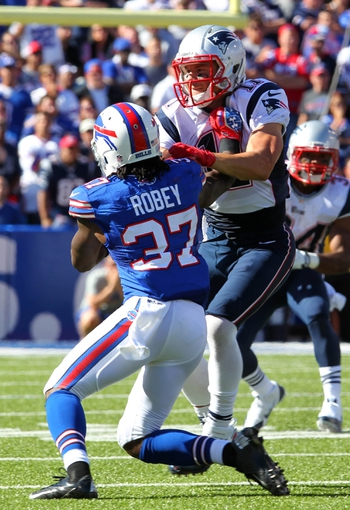 Sep 8, 2013; Orchard Park, NY, USA; New England Patriots wide receiver Julian Edelman (11) and Buffalo Bills defensive back Nickell Robey (37) fight for position during the second half at Ralph Wilson Stadium.  Patriots beat the Bills 23 to 21.  Mandatory Credit: Timothy T. Ludwig-USA TODAY Sports