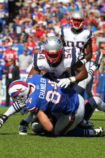 Sep 8, 2013; Orchard Park, NY, USA; New England Patriots outside linebacker Dont'a Hightower (54) tackles Buffalo Bills tight end Scott Chandler (84) during the second half at Ralph Wilson Stadium.  Patriots beat the Bills 23 to 21.  Mandatory Credit: Timothy T. Ludwig-USA TODAY Sports