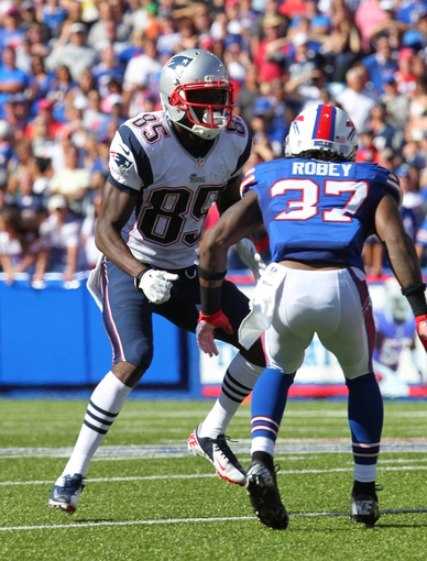 Sep 8, 2013; Orchard Park, NY, USA; Buffalo Bills defensive back Nickell Robey (37) tries to defend New England Patriots wide receiver Kenbrell Thompkins (85) during the second half at Ralph Wilson Stadium.  Patriots beat the Bills 23 to 21.  Mandatory Credit: Timothy T. Ludwig-USA TODAY Sports