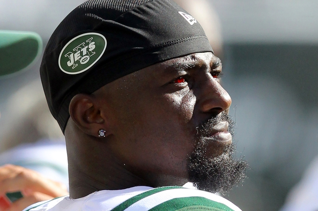 Sep 8, 2013; East Rutherford, NJ, USA; New York Jets wide receiver Santonio Holmes (10) watches from the sidelines during the fourth quarter of a game against the Tampa Bay Buccaneers at MetLife Stadium. The Jets won 18-17. Mandatory Credit: Brad Penner-USA TODAY Sports