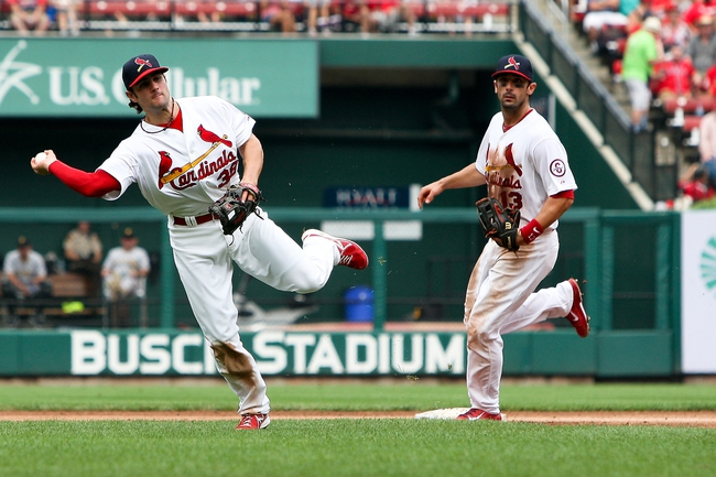 Sep 8, 2013; St. Louis, MO, USA; St. Louis Cardinals shortstop Pete Kozma (38) makes a play as Matt Carpenter covers second in the third inning against Pittsburgh Pirates at Busch Stadium. Mandatory Credit: Scott Kane-USA TODAY Sports