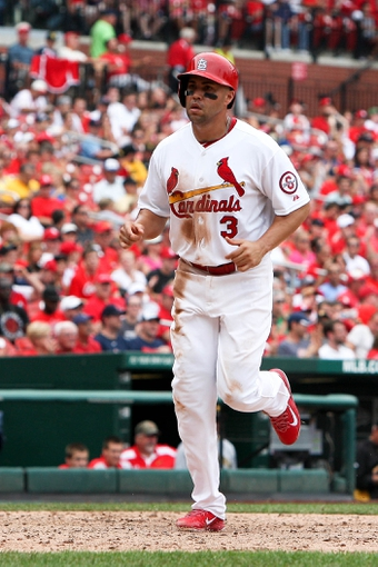 Sep 8, 2013; St. Louis, MO, USA; St. Louis Cardinals right fielder Carlos Beltran (3) scores a run on a single hit by David Freese in the fifth inning against the Pittsburgh Pirates at Busch Stadium. Mandatory Credit: Scott Kane-USA TODAY Sports