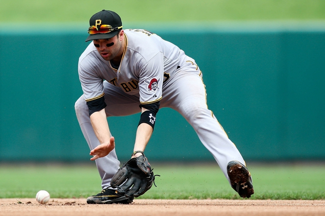Sep 8, 2013; St. Louis, MO, USA;  Pittsburgh Pirates second baseman Neil Walker (18) fields the ball against the St. Louis Cardinals at Busch Stadium. Mandatory Credit: Scott Kane-USA TODAY Sports