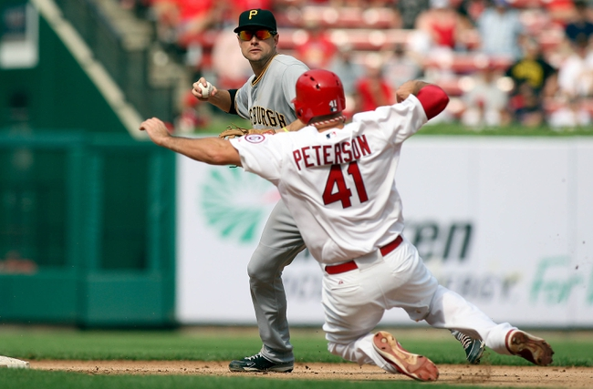 Sep 8, 2013; St. Louis, MO, USA;  Pittsburgh Pirates shortstop Jordy Mercer (10) is unable to turn a double play after making an out against St. Louis Cardinals Brock Peterson (41) at Busch Stadium. Mandatory Credit: Scott Kane-USA TODAY Sports