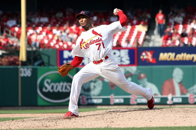 Sep 8, 2013; St. Louis, MO, USA; St. Louis Cardinals relief pitcher Sam Freeman (71) pitches in the ninth inning against the Pittsburgh Pirates at Busch Stadium. Mandatory Credit: Scott Kane-USA TODAY Sports