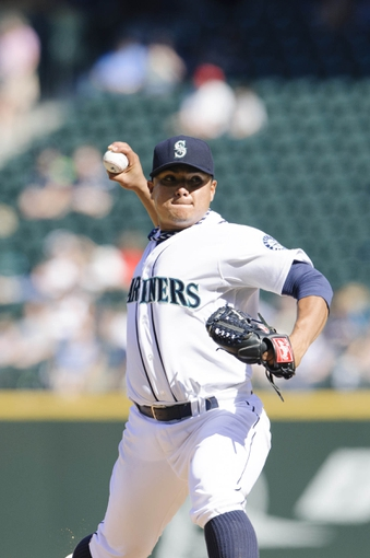 Sep 8, 2013; Seattle, WA, USA; Seattle Mariners starting pitcher Erasmo Ramirez (50) pitches to the Tampa Bay Rays during the 5th inning at Safeco Field. Mandatory Credit: Steven Bisig-USA TODAY Sports
