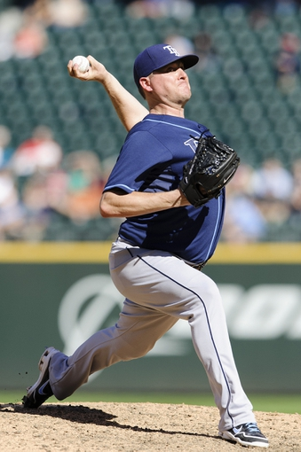 Sep 8, 2013; Seattle, WA, USA; Tampa Bay Rays relief pitcher Jake McGee (57) pitches to the Seattle Mariners during the 7th inning at Safeco Field. Mandatory Credit: Steven Bisig-USA TODAY Sports