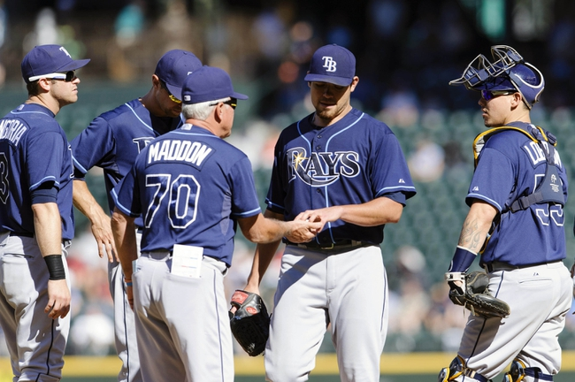 Sep 8, 2013; Seattle, WA, USA; Tampa Bay Rays manager Joe Maddon (70) takes the ball from Tampa Bay Rays starting pitcher Matt Moore (55) during the 7th inning at Safeco Field. Mandatory Credit: Steven Bisig-USA TODAY Sports