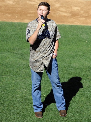 Sep 8, 2013; San Diego, CA, USA; Country music artist Scotty McCreery sings God Bless America during the seventh inning of the San Diego Padres game against the Colorado Rockies at Petco Park. Mandatory Credit: Christopher Hanewinckel-USA TODAY Sports