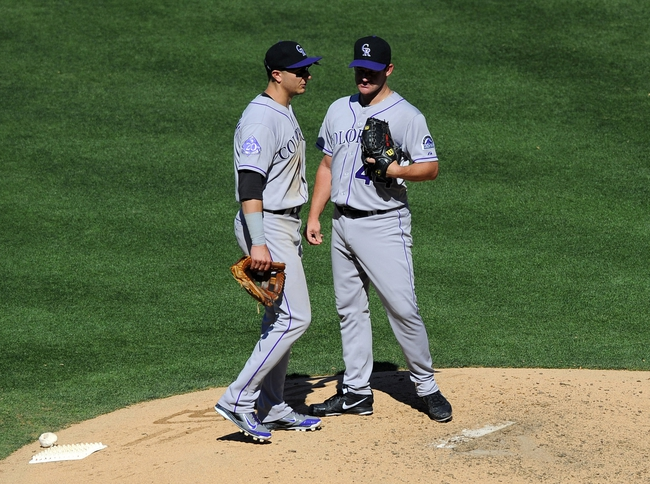 Sep 8, 2013; San Diego, CA, USA; Colorado Rockies shortstop Troy Tulowitzki (2) talks with Rockies pitcher Roy Oswalt (44) during the seventh inning against the San Diego Padres at Petco Park. Mandatory Credit: Christopher Hanewinckel-USA TODAY Sports