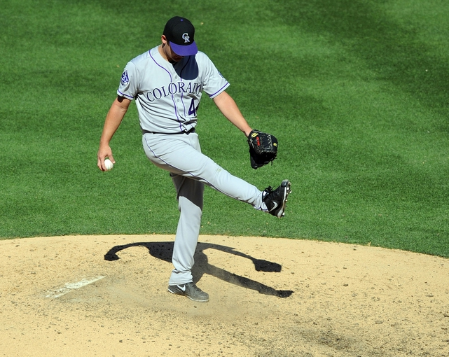 Sep 8, 2013; San Diego, CA, USA; Colorado Rockies pitcher Roy Oswalt (44) reacts after walking in the tying run during the seventh inning against the San Diego Padres at Petco Park. Mandatory Credit: Christopher Hanewinckel-USA TODAY Sports