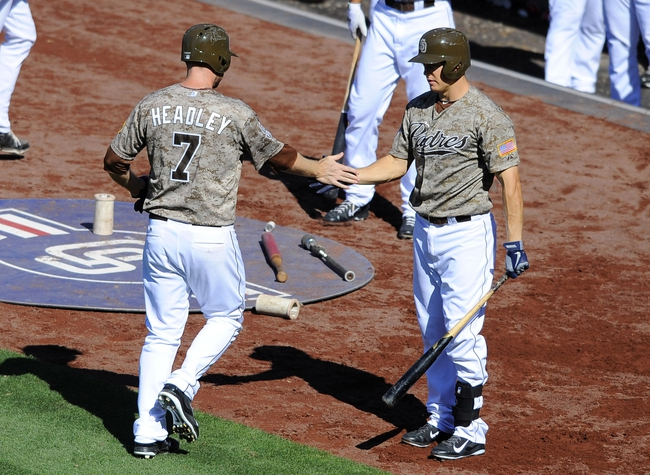 Sep 8, 2013; San Diego, CA, USA; San Diego Padres third baseman Chase Headley (7) is congratulated by Padres catcher Nick Hundley (4) after scoring to tie the game during the seventh inning against the Colorado Rockies at Petco Park.The Padres won 5-2. Mandatory Credit: Christopher Hanewinckel-USA TODAY Sports