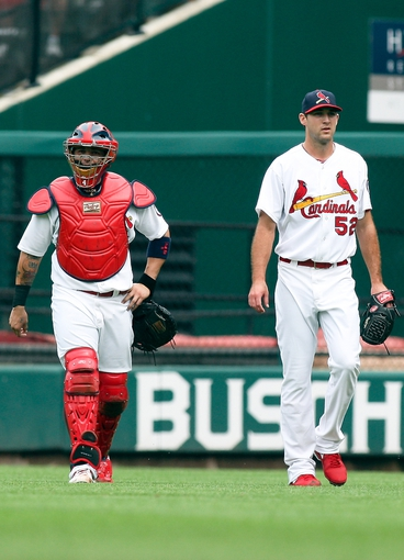 Sep 8, 2013; St. Louis, MO, USA; St. Louis Cardinals catcher Yadier Molina (4) and starting pitcher Michael Wacha (52) walk to the dugout prior to a game against the Pittsburgh Pirates at Busch Stadium. Mandatory Credit: Scott Kane-USA TODAY Sports