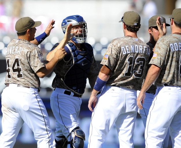 Sep 8, 2013; San Diego, CA, USA; San Diego Padres catcher Nick Hundley (4) celebrates with teammates after a win against the Colorado Rockies at Petco Park. The Padres won 5-2. Mandatory Credit: Christopher Hanewinckel-USA TODAY Sports