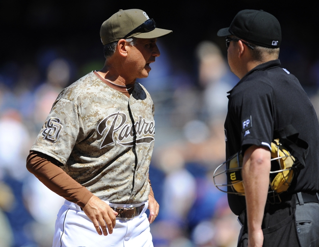 Sep 8, 2013; San Diego, CA, USA; San Diego Padres manager Bud Black (20) questions a call made by home plate umpire Todd Tichenor (right) following an attempt to score by Padres center fielder Reymond Fuentes (not pictured) during the third inning against the Colorado Rockies at Petco Park. Mandatory Credit: Christopher Hanewinckel-USA TODAY Sports