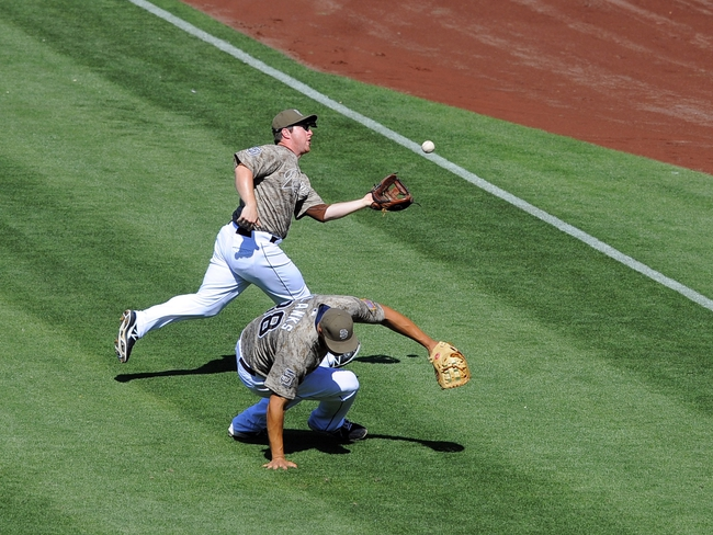 Sep 8, 2013; San Diego, CA, USA; San Diego Padres second baseman Jedd Gyorko (9) catches a fly ball in shallow right field behind first baseman Kyle Blanks (88) during the seventh inning against the Colorado Rockies at Petco Park. Mandatory Credit: Christopher Hanewinckel-USA TODAY Sports