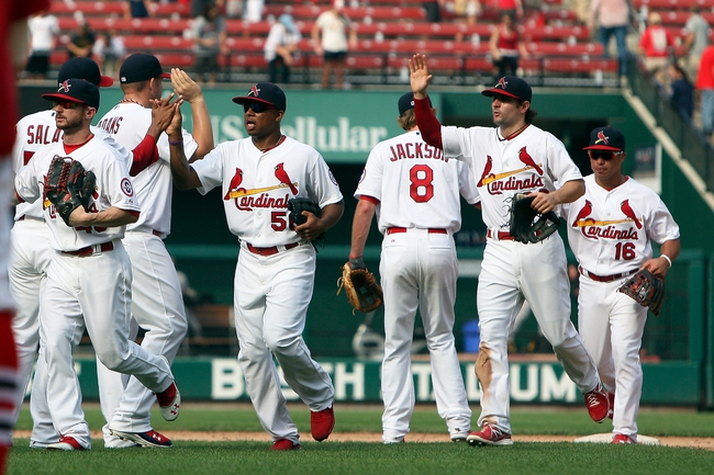 Sep 8, 2013; St. Louis, MO, USA; Members of the St. Louis Cardinals congratulate each other after their 9-2 victory against the Pittsburgh Pirates at Busch Stadium. Mandatory Credit: Scott Kane-USA TODAY Sports
