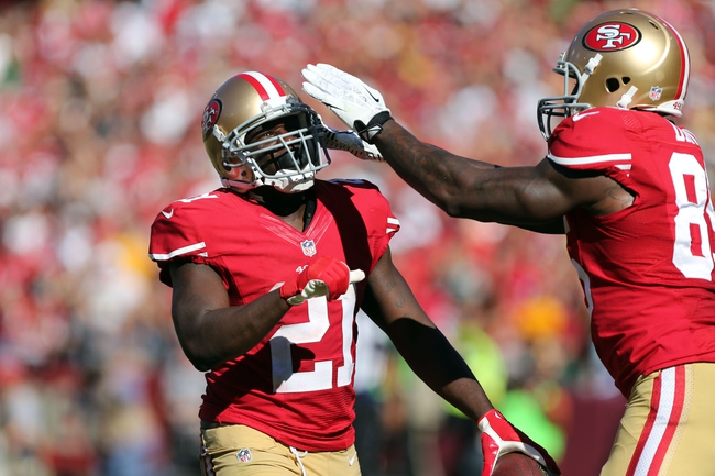 Sep 8, 2013; San Francisco, CA, USA; San Francisco 49ers tight end Vernon Davis (85) drums on the helmet of running back Frank Gore (21) after scoring a touchdown against the Green Bay Packers during the fourth quarter at Candlestick Park. The San Francisco 49ers defeated the Green Bay Packers 34-28. Mandatory Credit: Kelley L Cox-USA TODAY Sports