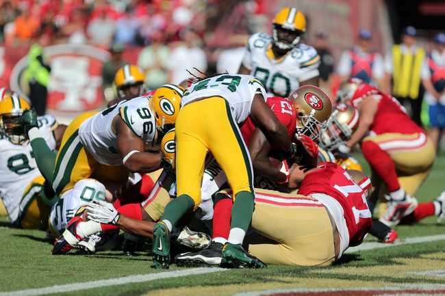 Sep 8, 2013; San Francisco, CA, USA; San Francisco 49ers running back Frank Gore (21) scores a touchdown against the Green Bay Packers during the fourth quarter at Candlestick Park. The San Francisco 49ers defeated the Green Bay Packers 34-28. Mandatory Credit: Kelley L Cox-USA TODAY Sports
