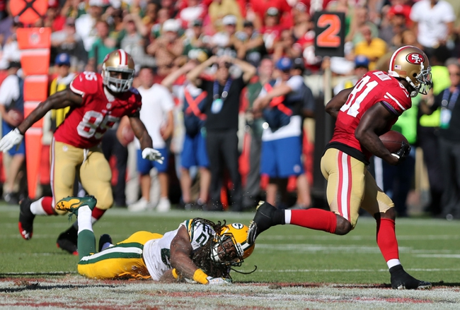 Sep 8, 2013; San Francisco, CA, USA; Green Bay Packers defensive back Jerron McMillian (22) is unable to make the tackle against San Francisco 49ers wide receiver Anquan Boldin (81) during the fourth quarter at Candlestick Park. The San Francisco 49ers defeated the Green Bay Packers 34-28. Mandatory Credit: Kelley L Cox-USA TODAY Sports