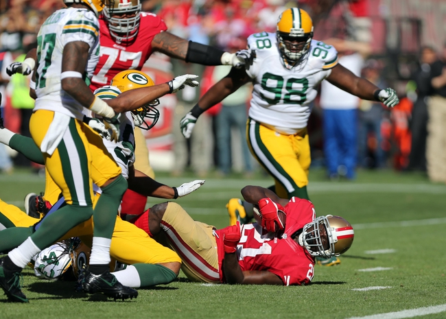 Sep 8, 2013; San Francisco, CA, USA; San Francisco 49ers running back Frank Gore (21) falls short of the goal line against the Green Bay Packers during the fourth quarter at Candlestick Park. The San Francisco 49ers defeated the Green Bay Packers 34-28. Mandatory Credit: Kelley L Cox-USA TODAY Sports