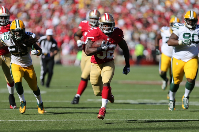 Sep 8, 2013; San Francisco, CA, USA; San Francisco 49ers running back Kendall Hunter (32) carries the ball against the Green Bay Packers during the fourth quarter at Candlestick Park. The San Francisco 49ers defeated the Green Bay Packers 34-28. Mandatory Credit: Kelley L Cox-USA TODAY Sports