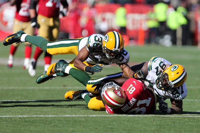Sep 8, 2013; San Francisco, CA, USA; Green Bay Packers cornerback Tramon Williams (38) and defensive tackle Johnny Jolly (97) tackle San Francisco 49ers wide receiver Anquan Boldin (81) during the fourth quarter at Candlestick Park. The San Francisco 49ers defeated the Green Bay Packers 34-28. Mandatory Credit: Kelley L Cox-USA TODAY Sports