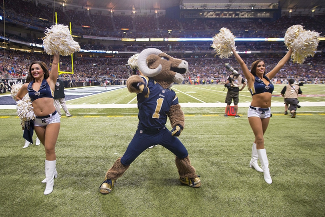 Sep 8, 2013; St. Louis, MO, USA; St. Louis Rams mascot Rampage and cheerleaders perform during the second half against the Arizona Cardinals at Edward Jones Dome. The Rams defeated the Cardinals 27-24. Mandatory Credit: Scott Rovak-USA TODAY Sports