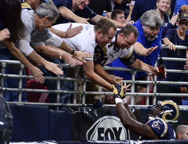Sep 8, 2013; St. Louis, MO, USA; St. Louis Rams tight end Jared Cook (89) is congratulated by fans after scoring a touchdown against the Arizona Cardinals during the second half at Edward Jones Dome. The Rams defeated the Cardinals 27-24. Mandatory Credit: Scott Rovak-USA TODAY Sports