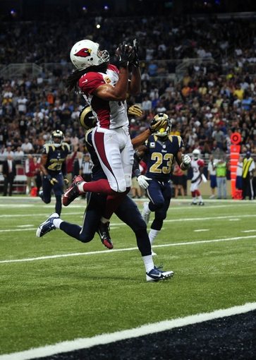 Sep 8, 2013; St. Louis, MO, USA; Arizona Cardinals wide receiver Larry Fitzgerald (11) catches a 24 yard touchdown pass against the St. Louis Rams during the second half at Edward Jones Dome. St. Louis defeated Arizona 27-24. Mandatory Credit: Jeff Curry-USA TODAY Sports