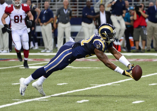 Sep 8, 2013; St. Louis, MO, USA; St. Louis Rams linebacker Alec Ogletree (52) misses an interception against the Arizona Cardinals during the second half at Edward Jones Dome. The Rams defeated the Cardinals 27-24. Mandatory Credit: Scott Rovak-USA TODAY Sports