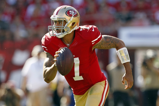 Sep 8, 2013; San Francisco, CA, USA; San Francisco 49ers quarterback Colin Kaepernick (7) runs with the ball against the Green Bay Packers in the fourth quarter at Candlestick Park. The 49ers defeated the Packers 34-28. Mandatory Credit: Cary Edmondson-USA TODAY Sports