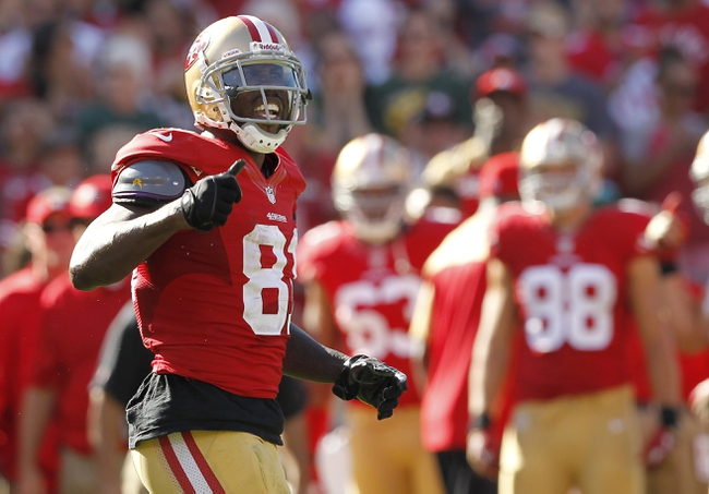 Sep 8, 2013; San Francisco, CA, USA; San Francisco 49ers wide receiver Anquan Boldin (81) reacts after picking up a first down against the Green Bay Packers in the fourth quarter at Candlestick Park. The 49ers defeated the Packers 34-28. Mandatory Credit: Cary Edmondson-USA TODAY Sports