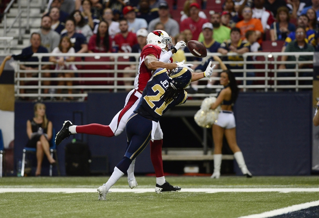 Sep 8, 2013; St. Louis, MO, USA; St. Louis Rams cornerback Janoris Jenkins (21) defends against Arizona Cardinals wide receiver Michael Floyd (15) during the second half at Edward Jones Dome. St. Louis defeated Arizona 27-24. Mandatory Credit: Jeff Curry-USA TODAY Sports