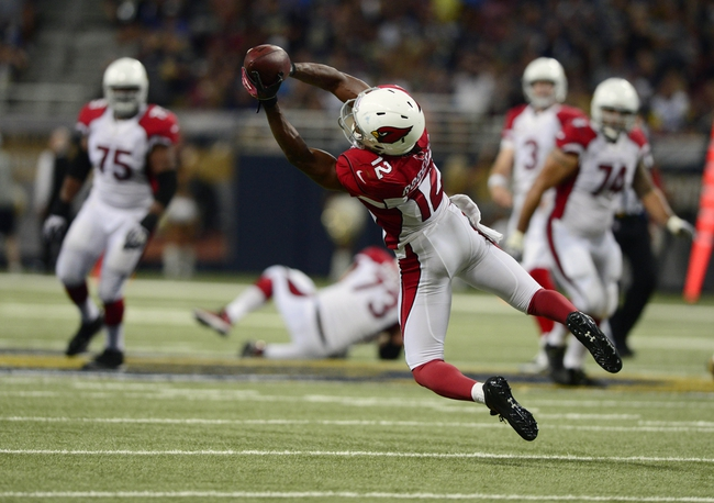 Sep 8, 2013; St. Louis, MO, USA; Arizona Cardinals wide receiver Andre Roberts (12) catches a 16 yard pass against the St. Louis Rams during the second half at Edward Jones Dome. St. Louis defeated Arizona 27-24. Mandatory Credit: Jeff Curry-USA TODAY Sports