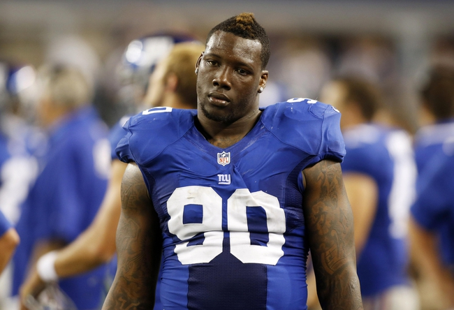 Sep 8, 2013; Arlington, TX, USA;  New York Giants defensive end Jason Pierre-Paul (90) on the sidelines during the fourth quarter of the game against the Dallas Cowboys at AT&T Stadium. The Dallas Cowboys beat the New York Giants 36-31. Mandatory Credit: Tim Heitman-USA TODAY Sports