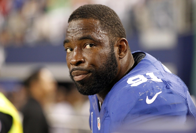 Sep 8, 2013; Arlington, TX, USA; New York Giants defensive end Justin Tuck (91) on the sidelines during the fourth quarter of the game against the Dallas Cowboys  at AT&T Stadium.  The Dallas Cowboys beat the New York Giants 36-31. Mandatory Credit: Tim Heitman-USA TODAY Sports